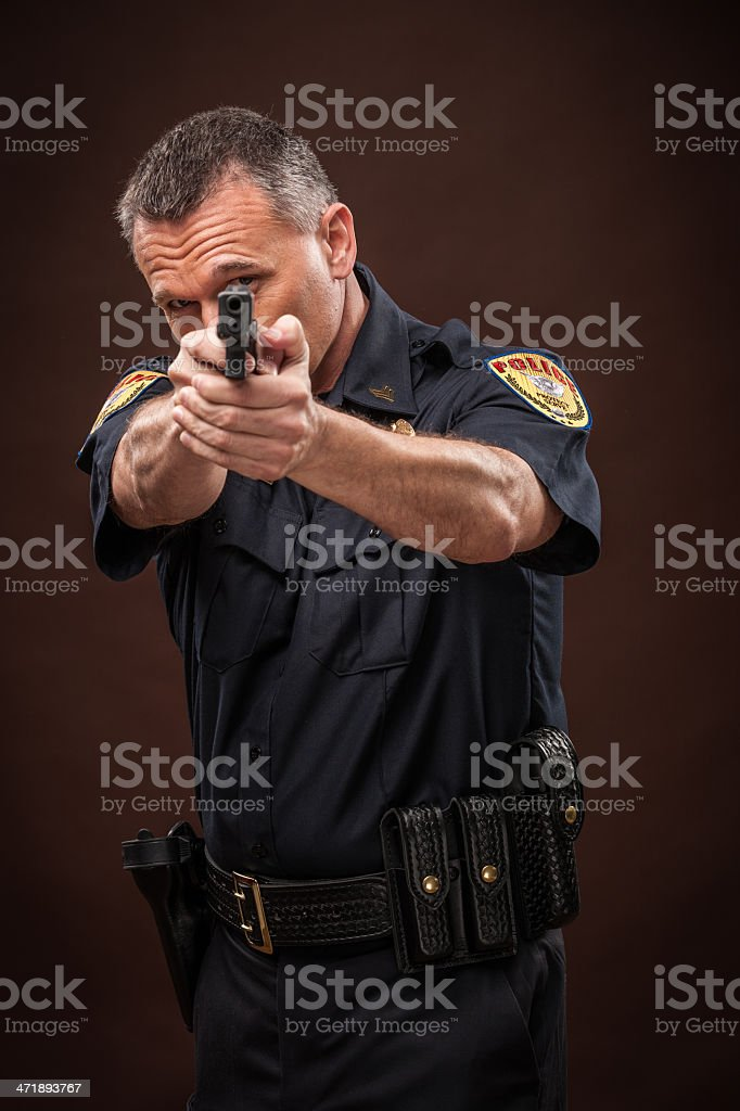 Police Officer Pointing Gun stock photo