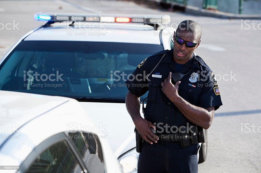 Police officer pulling over a car stock photo