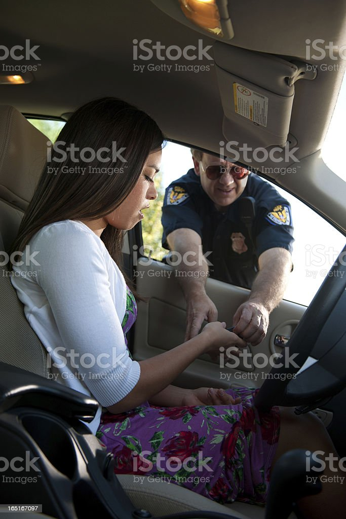 Police Officer Reprimand Female Driver stock photo