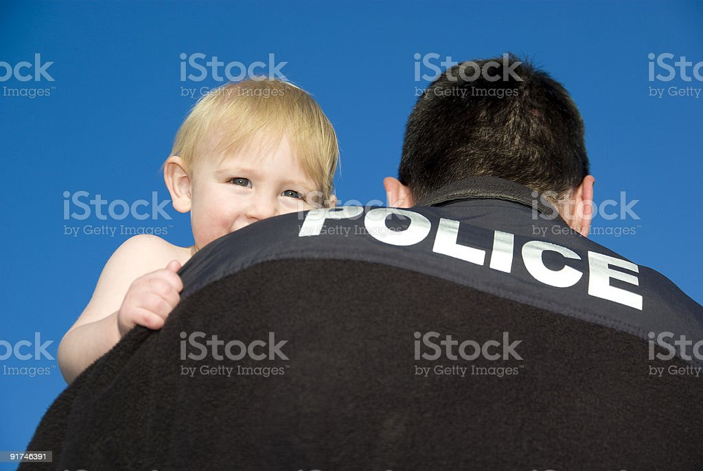 Police Officer rescues baby royalty-free stock photo