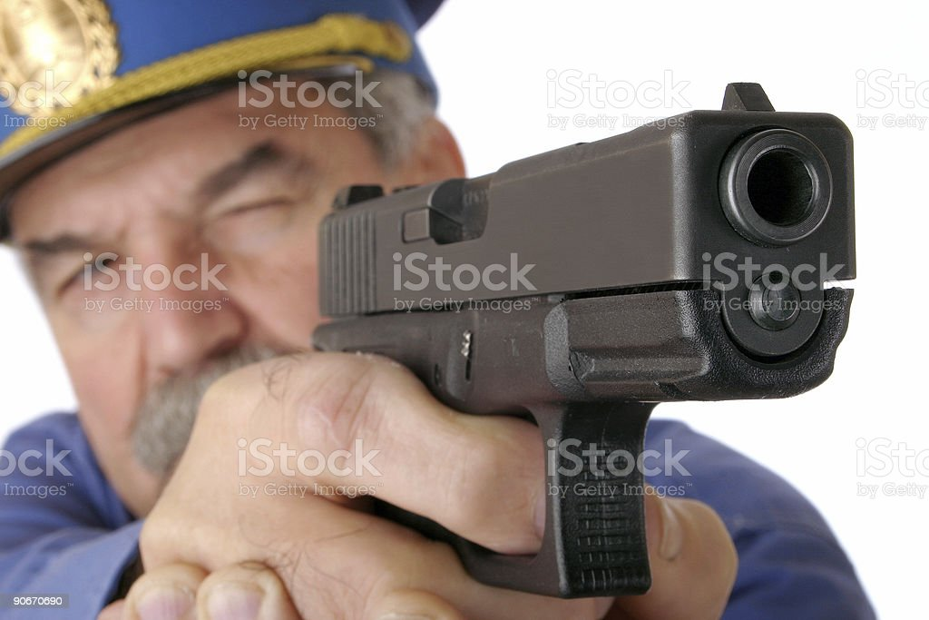 Police officer shooting with handgun royalty-free stock photo