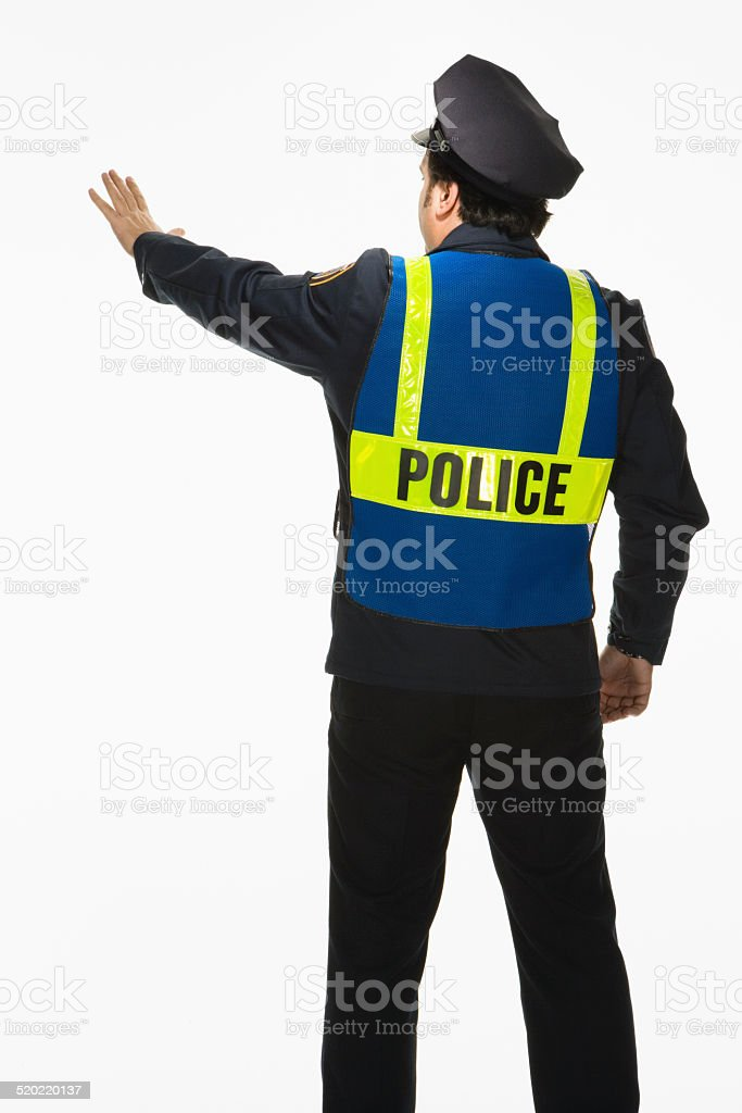 Police officer signally stop on white background stock photo