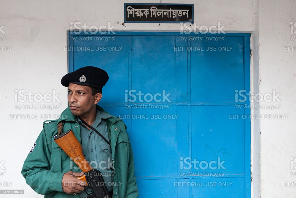 Police officer stands guard stock photo