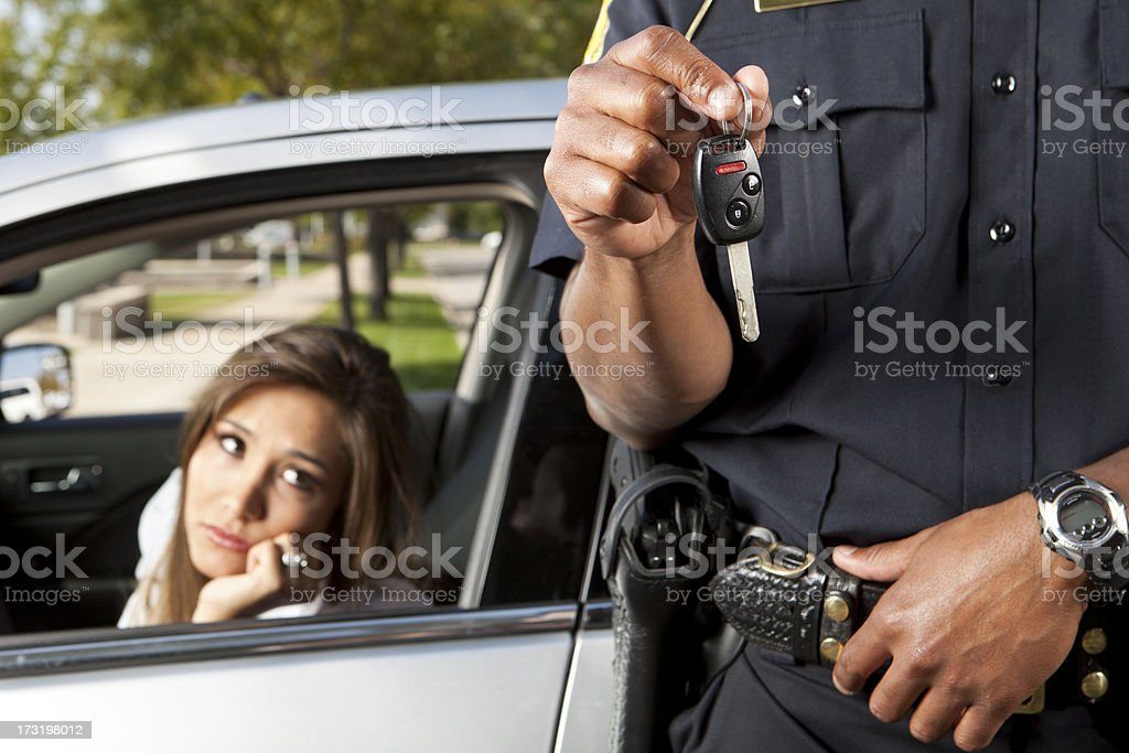 Police Officer taking keys from Driver stock photo