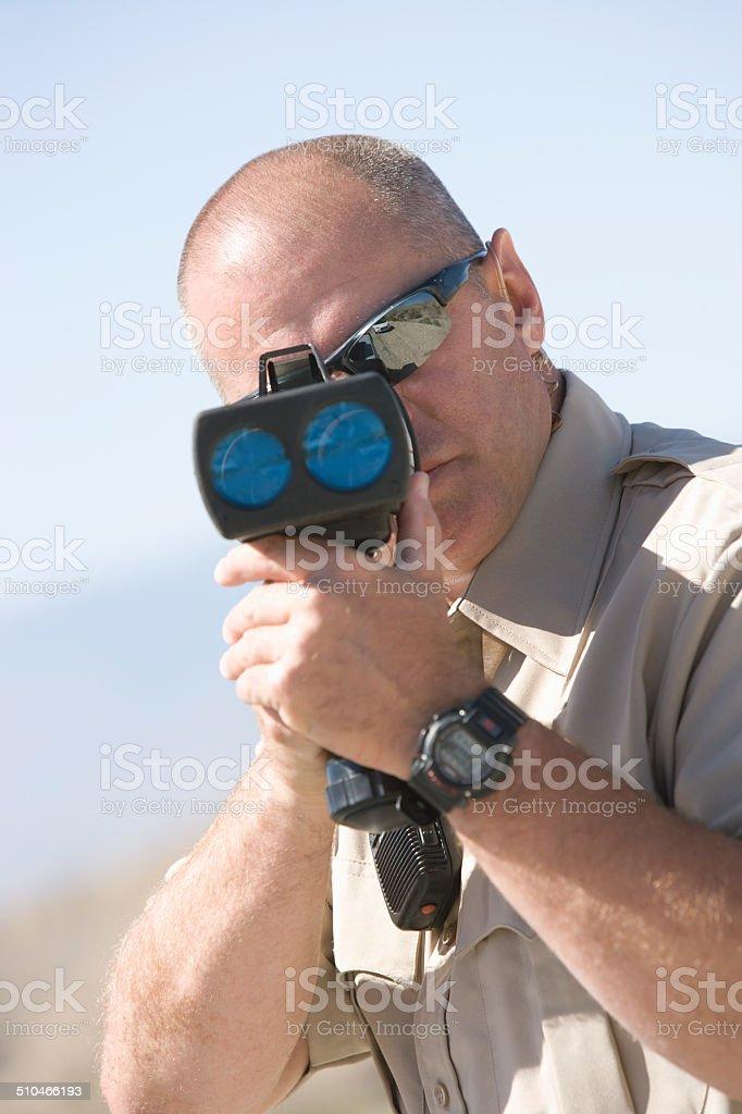 Police officer using speed gun stock photo