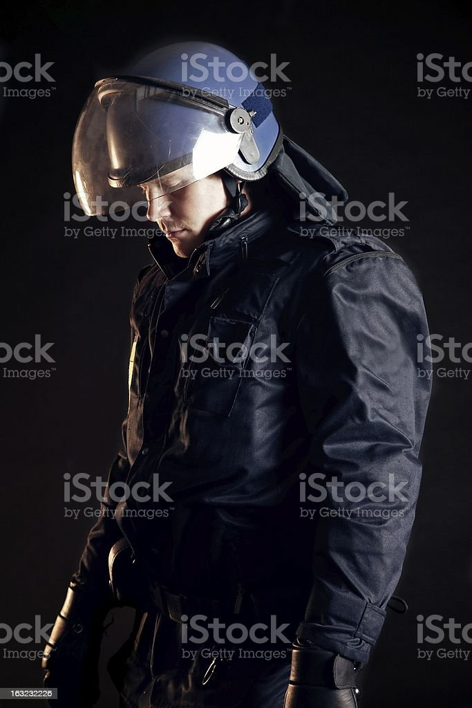 Police Officer Wearing Protective Uniform stock photo