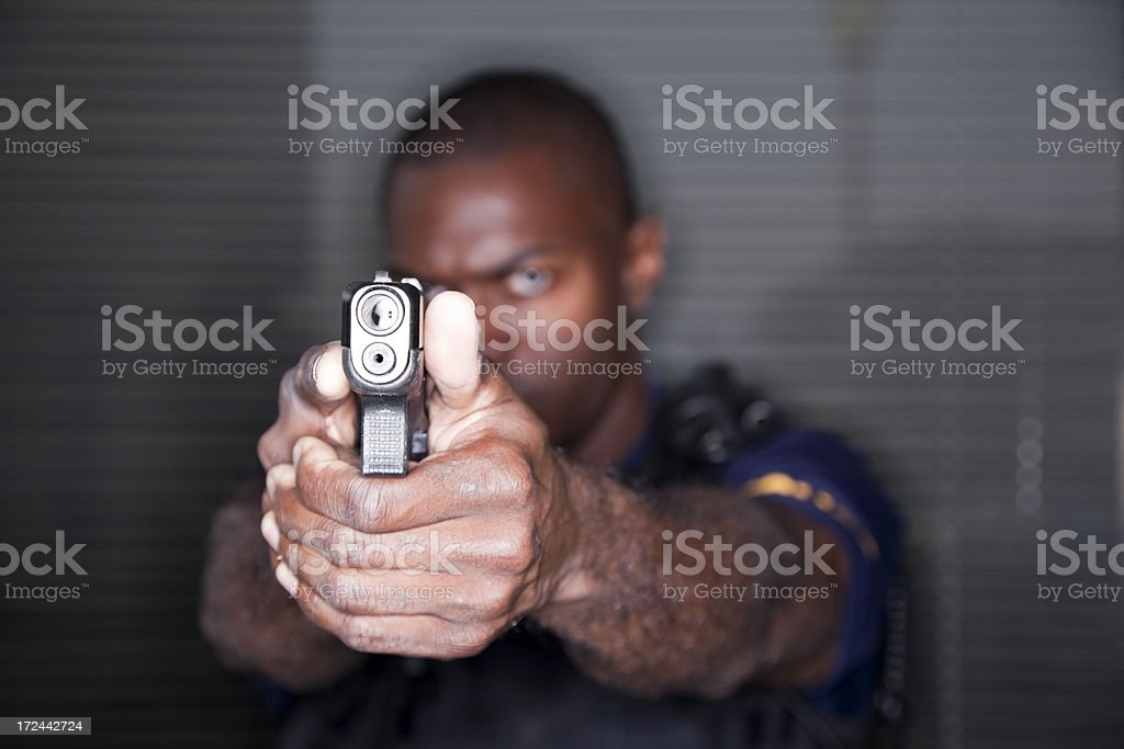 Police officer with a gun stock photo