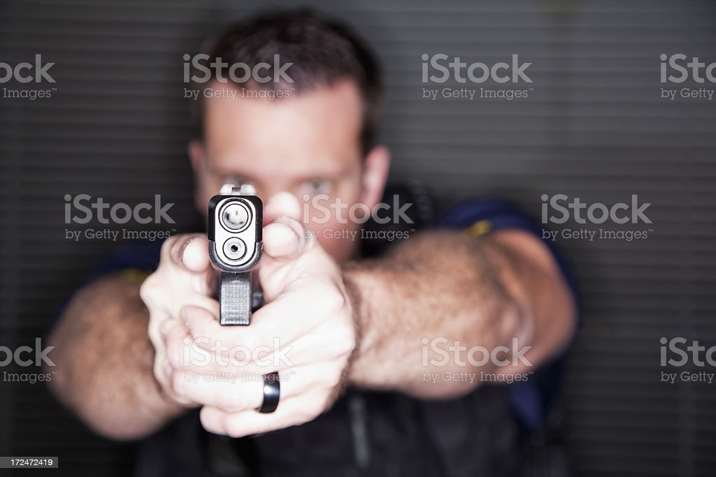 Police officer with a gun royalty-free stock photo