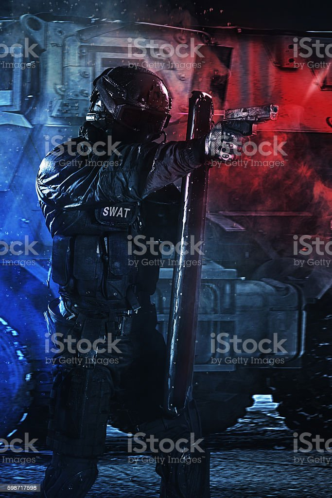 police officer with ballistic shield stock photo
