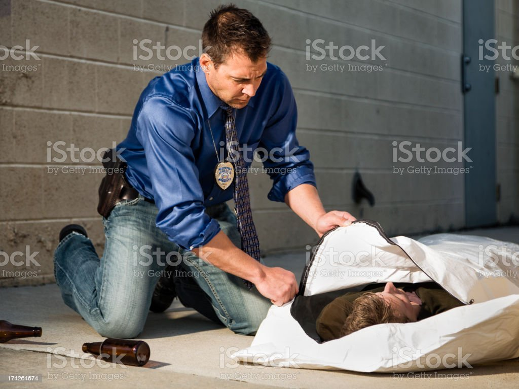 Police Officer with Body Bag royalty-free stock photo