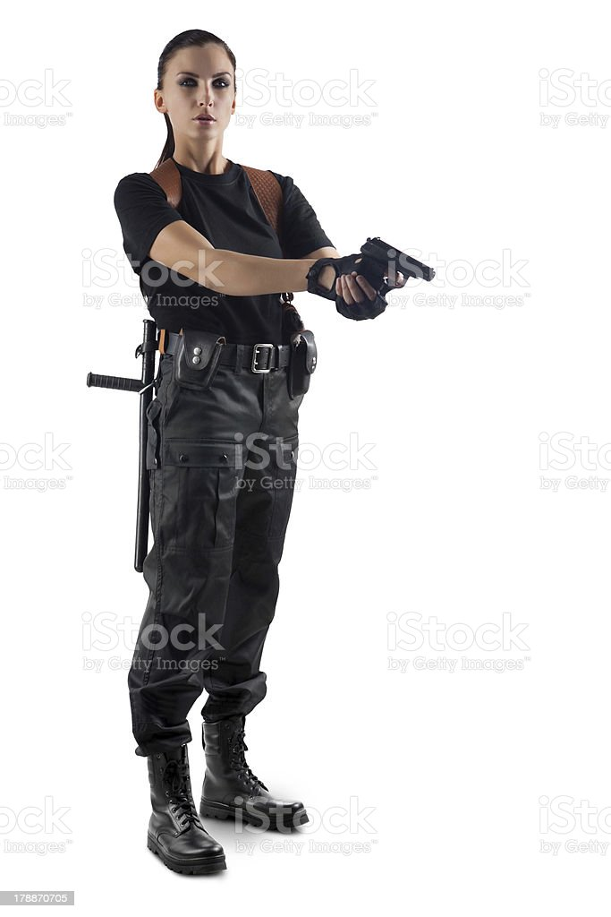 Police officer with gun is aiming stock photo