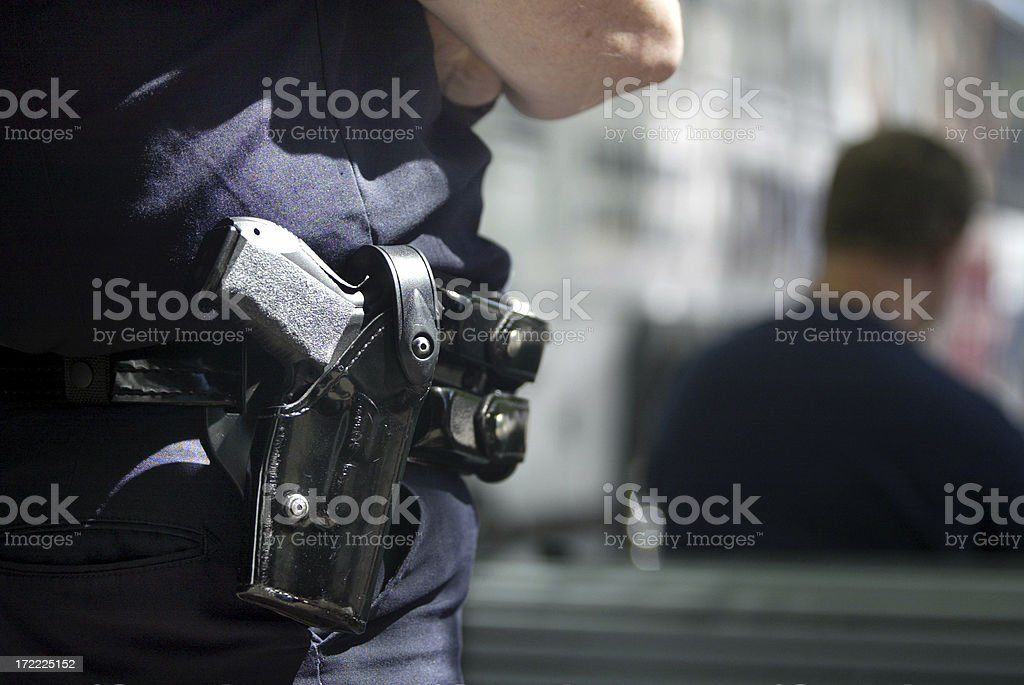 Police officer with handgun in holster stock photo