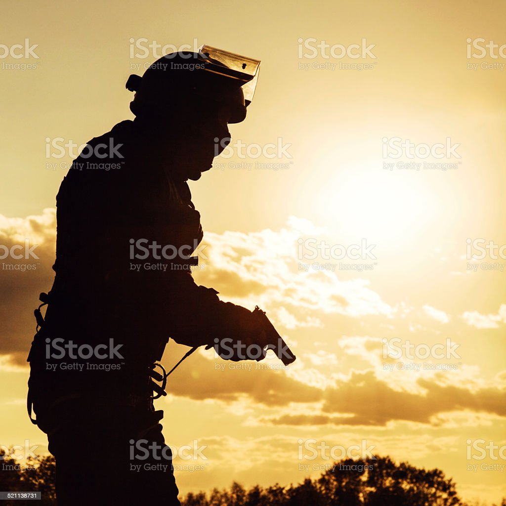police officer with pistol stock photo