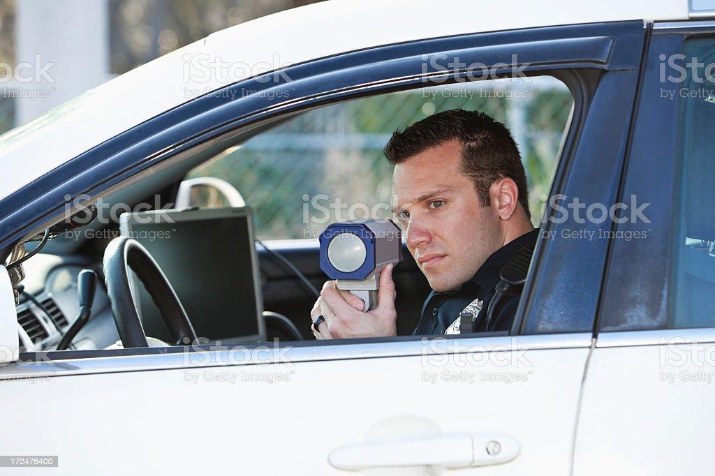 Police officer with radar gun stock photo