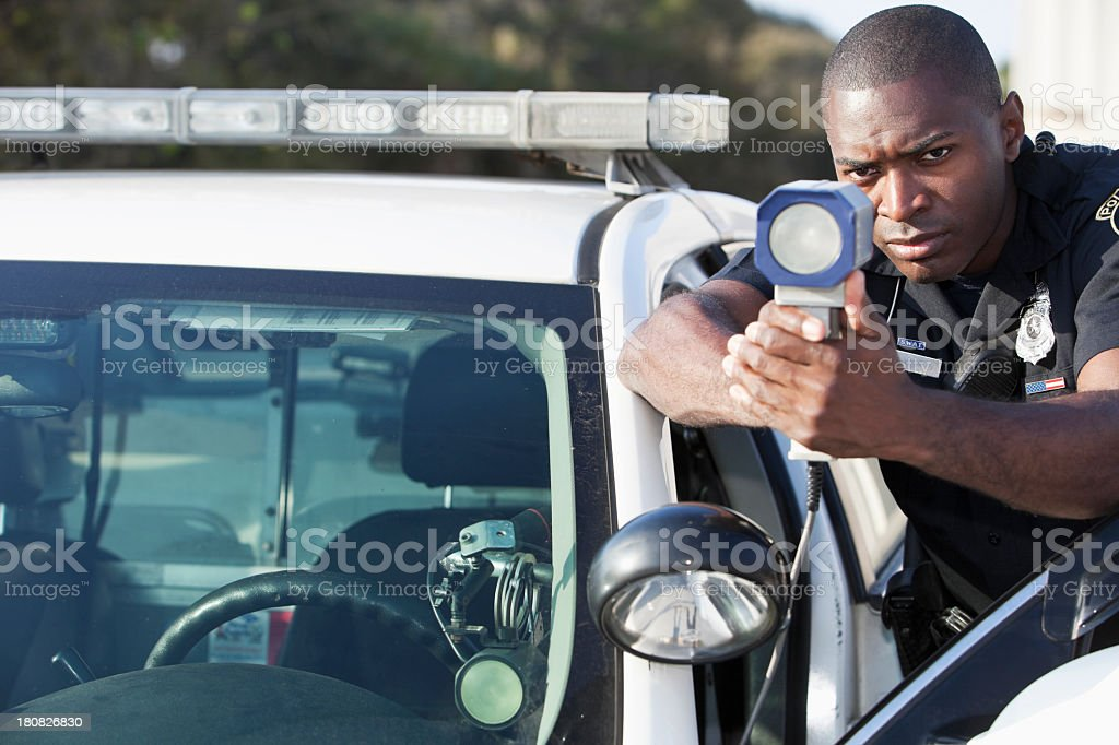 Police officer with radar gun stock photo