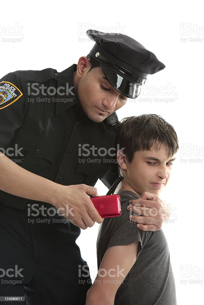 Police officer with teen juvenile delinquent stock photo