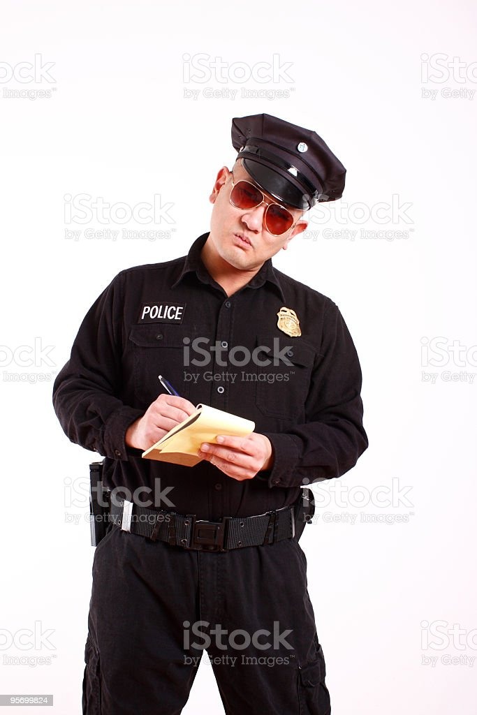 police officer writing a citation stock photo