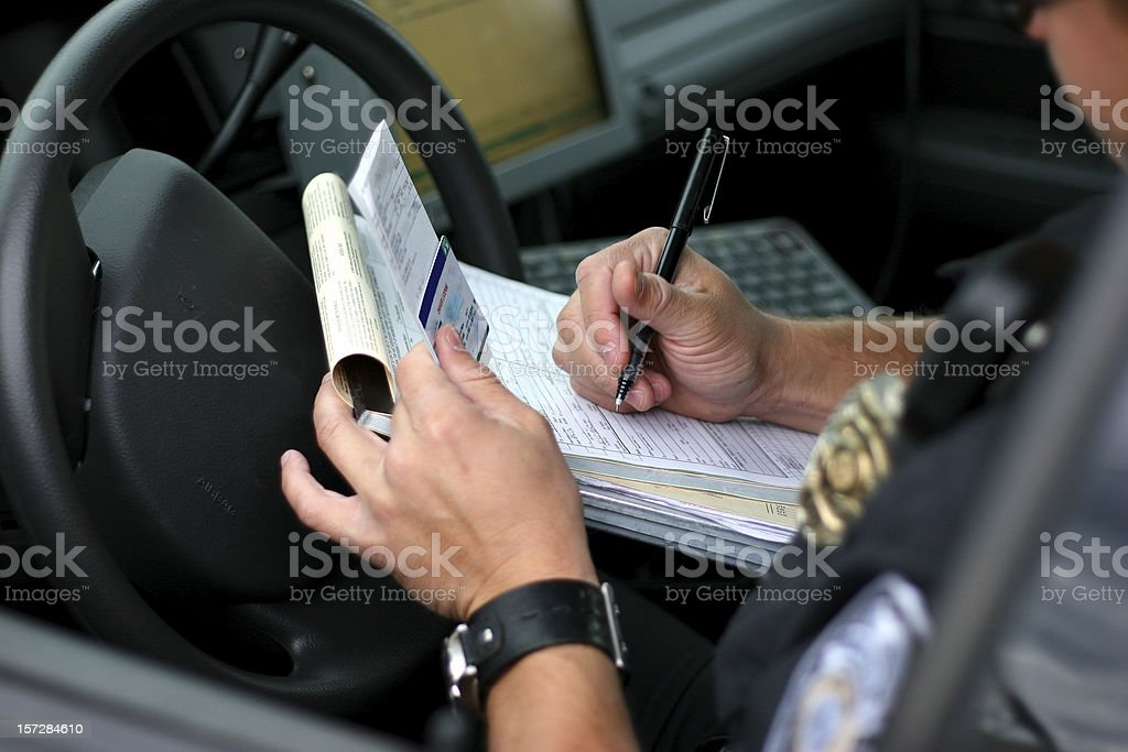 Police Officer Writing Ticket 2 stock photo