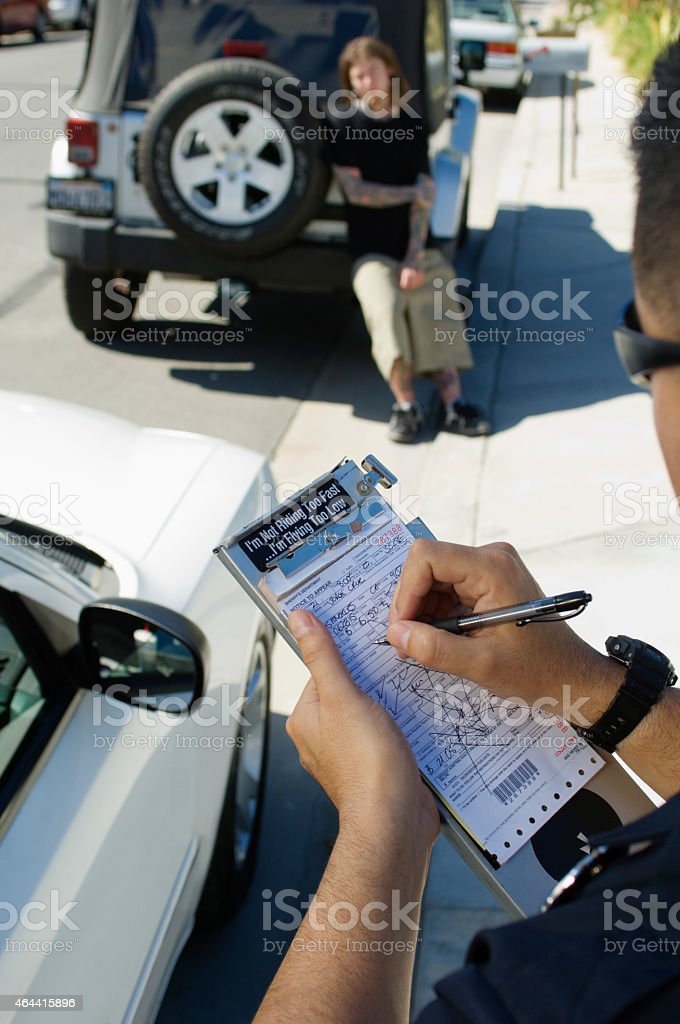 Police Officer Writing Ticket stock photo