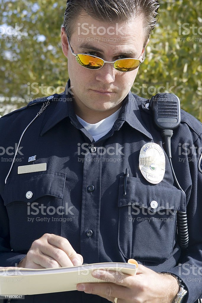 Police Officer Writing Up Ticket royalty-free stock photo