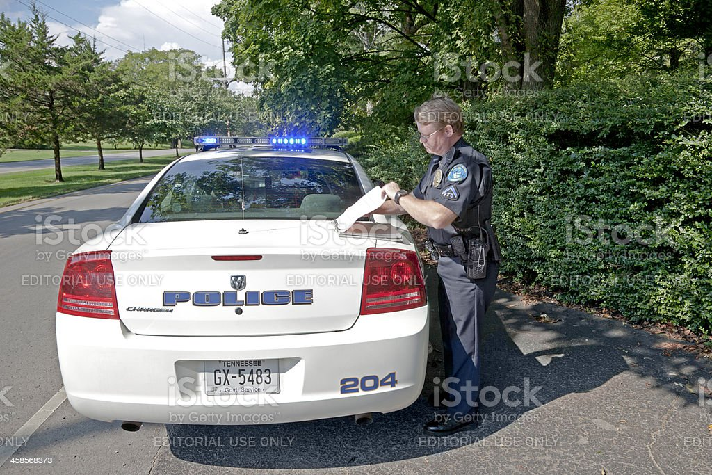 Police Officer Writting Ticket stock photo