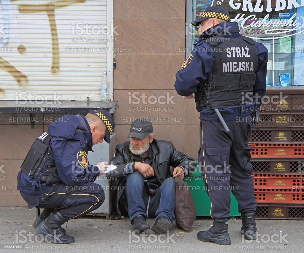 police officers are checking some strange man stock photo