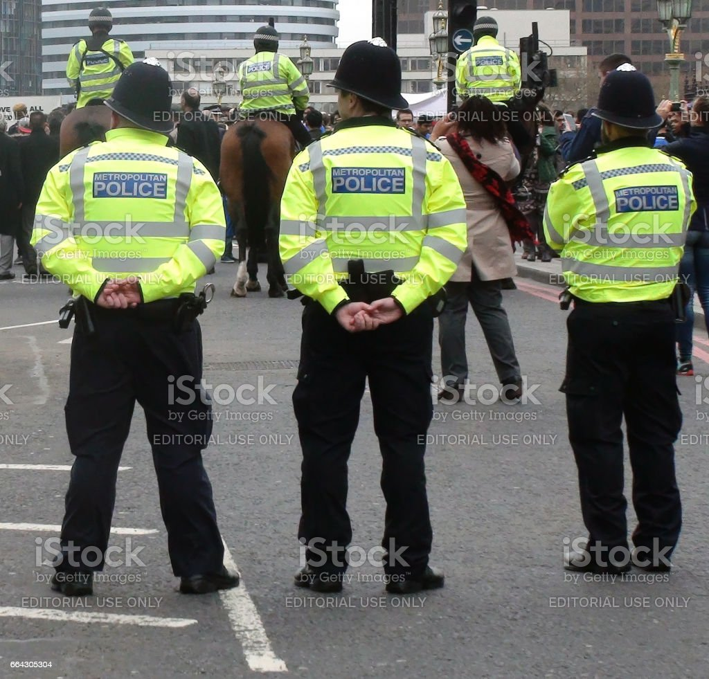 Police Officers At March 2017 Terrorist Attack Anniversary In Westminster London stock photo