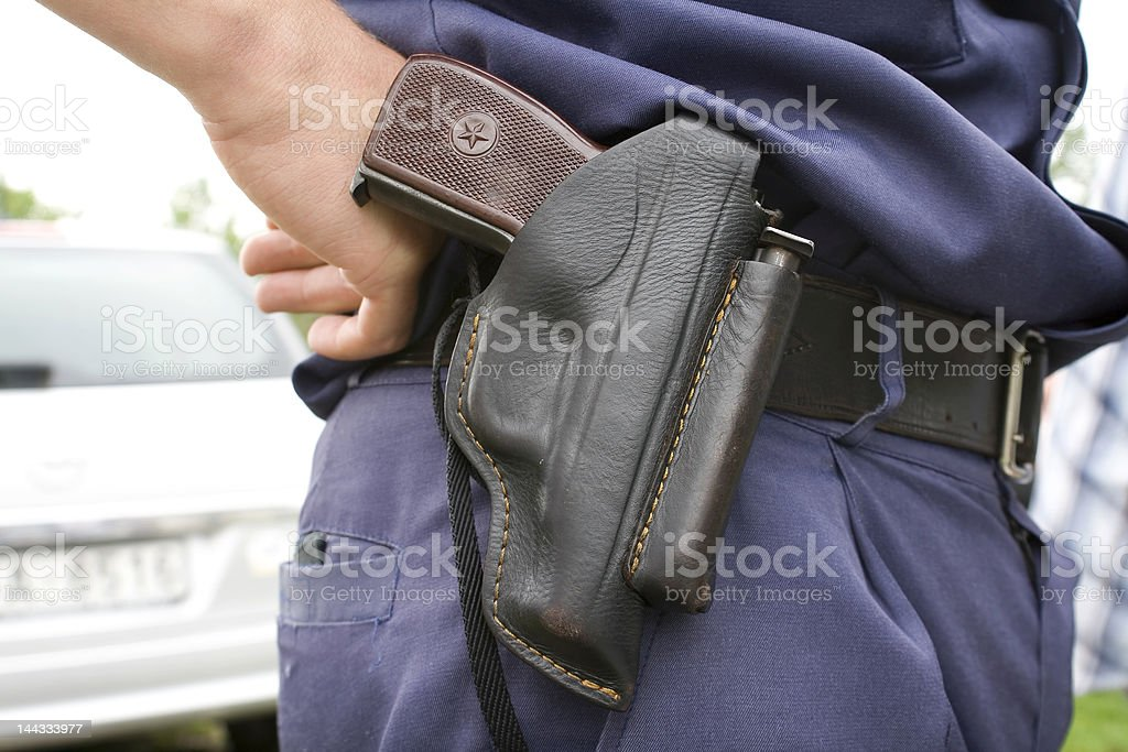 Police officer`s holster with gun. stock photo