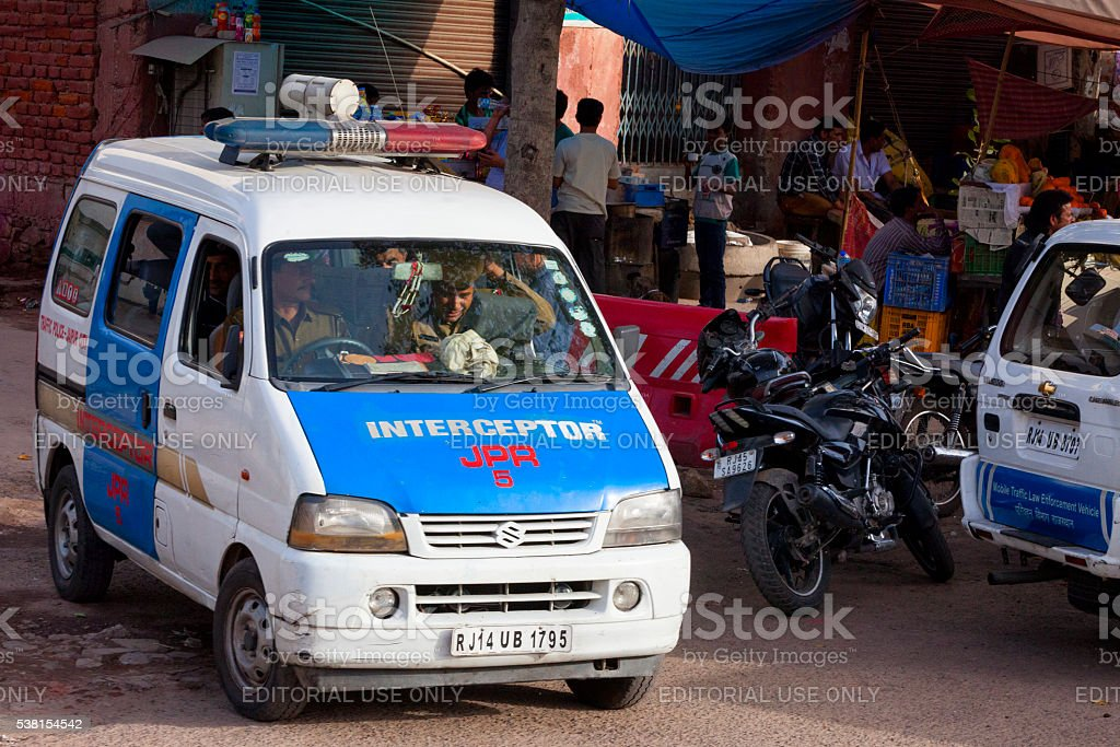 Police officers in vehicle on the streets of Jaipur, India stock photo