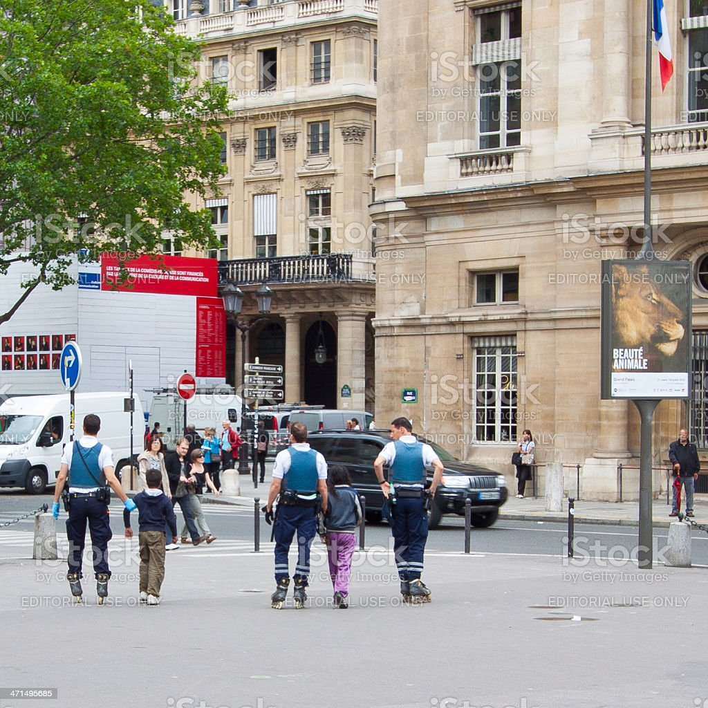 Police officers on rollerblades detained two little thiefs in Paris. royalty-free stock photo