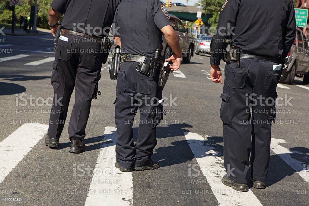 NYPD police officers patrol the Atlantic Antic street fair Brooklyn stock photo