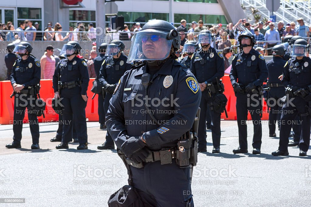Police officers ready in riot gear stock photo