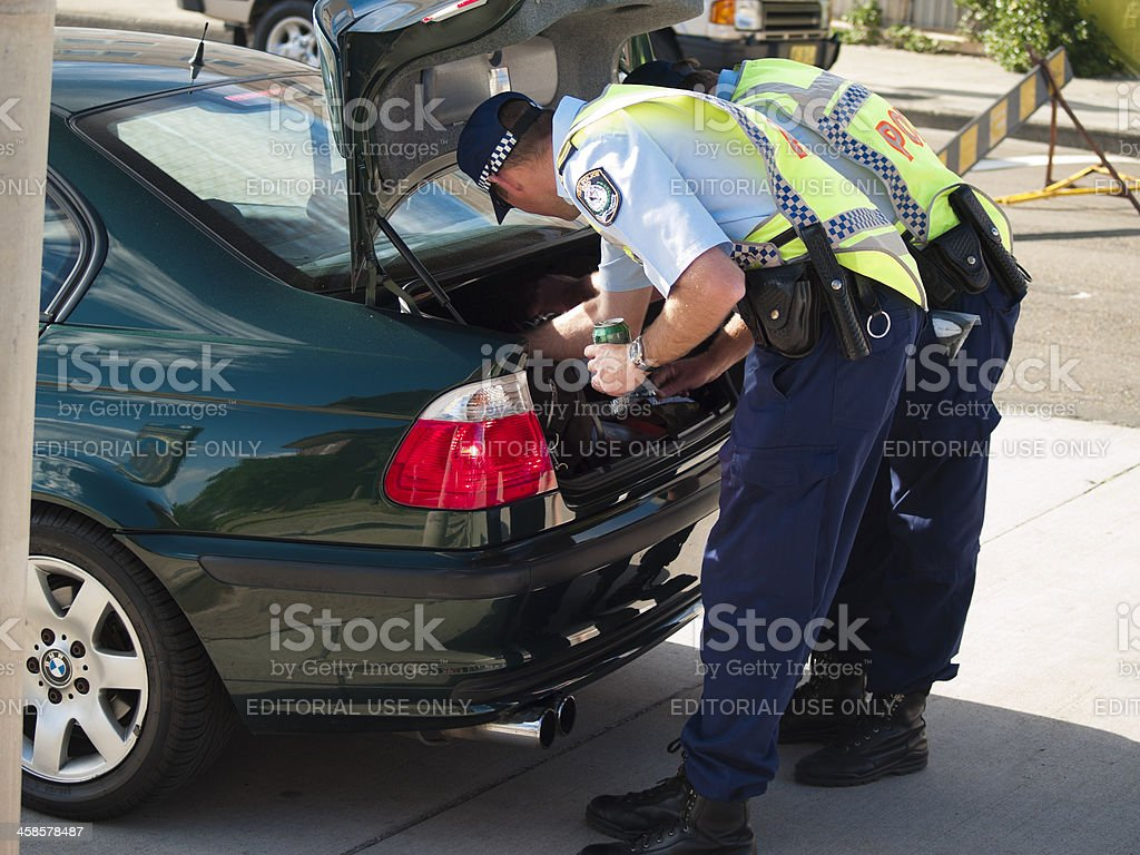 Police officers search car Coogee, Sydney royalty-free stock photo