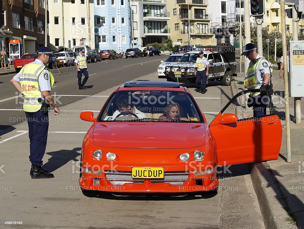 Police officers search car Coogee, Sydney stock photo