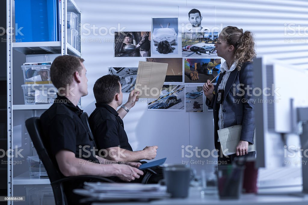 Police officers searching files stock photo