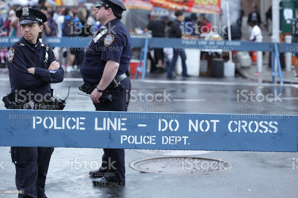 NYPD police officers stand in Brooklyn street stock photo