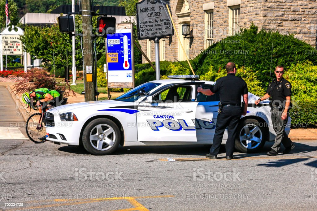 Police Officers standing by their patrol vehicle in Canton, NC, USA stock photo