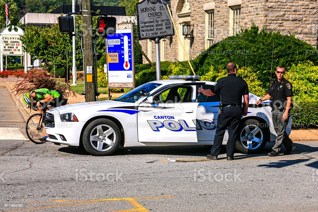 Police Officers standing outside of their vehicle in Canton, NC. stock photo