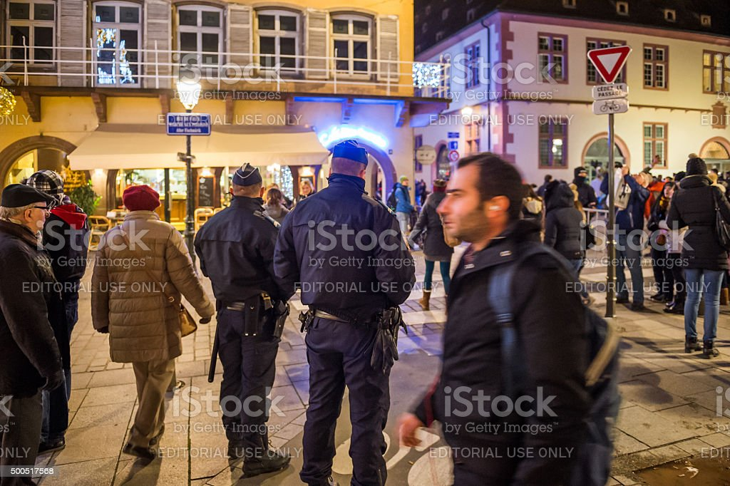 Police officers surveilling Christmas Market stock photo