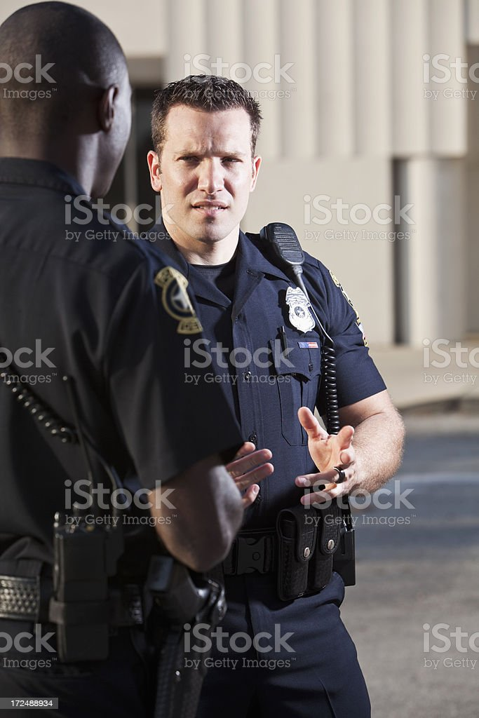 Police officers talking stock photo