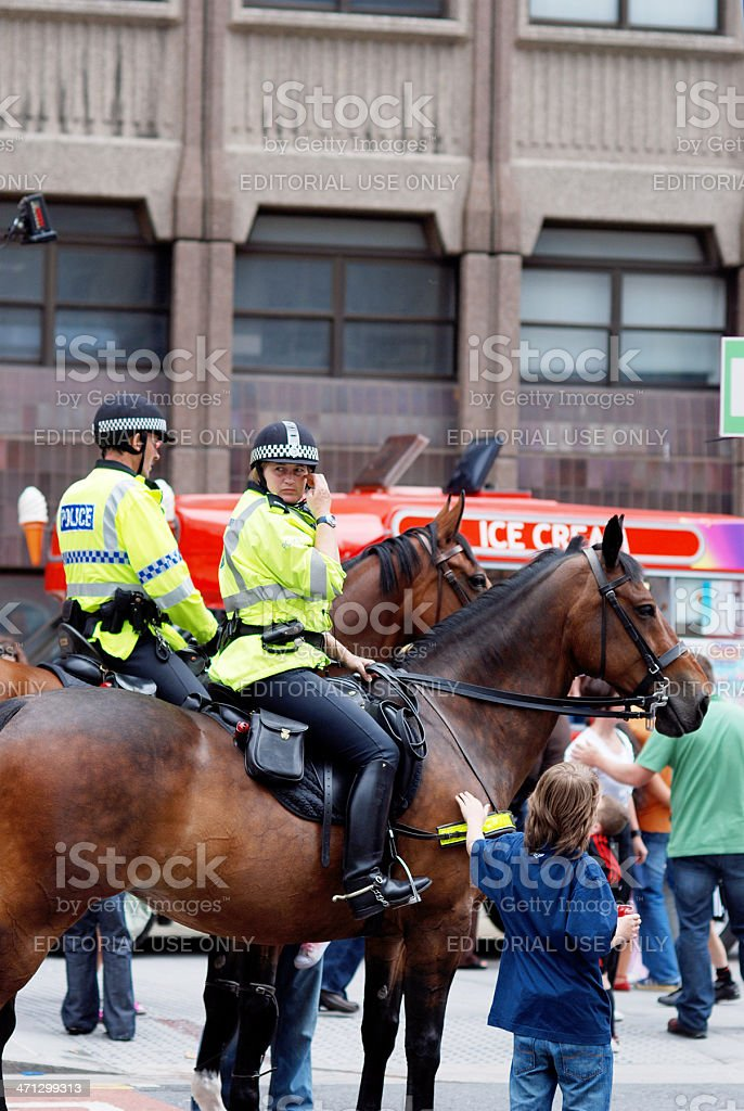 Police officers with horse during Mathew Street Festival royalty-free stock photo