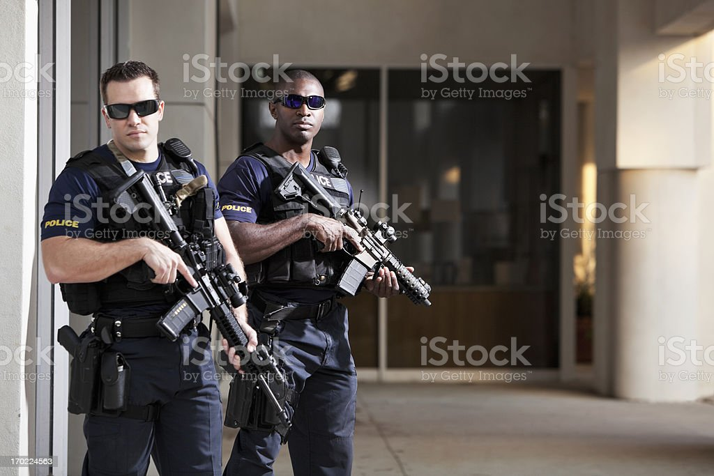 Police officers with rifles royalty-free stock photo
