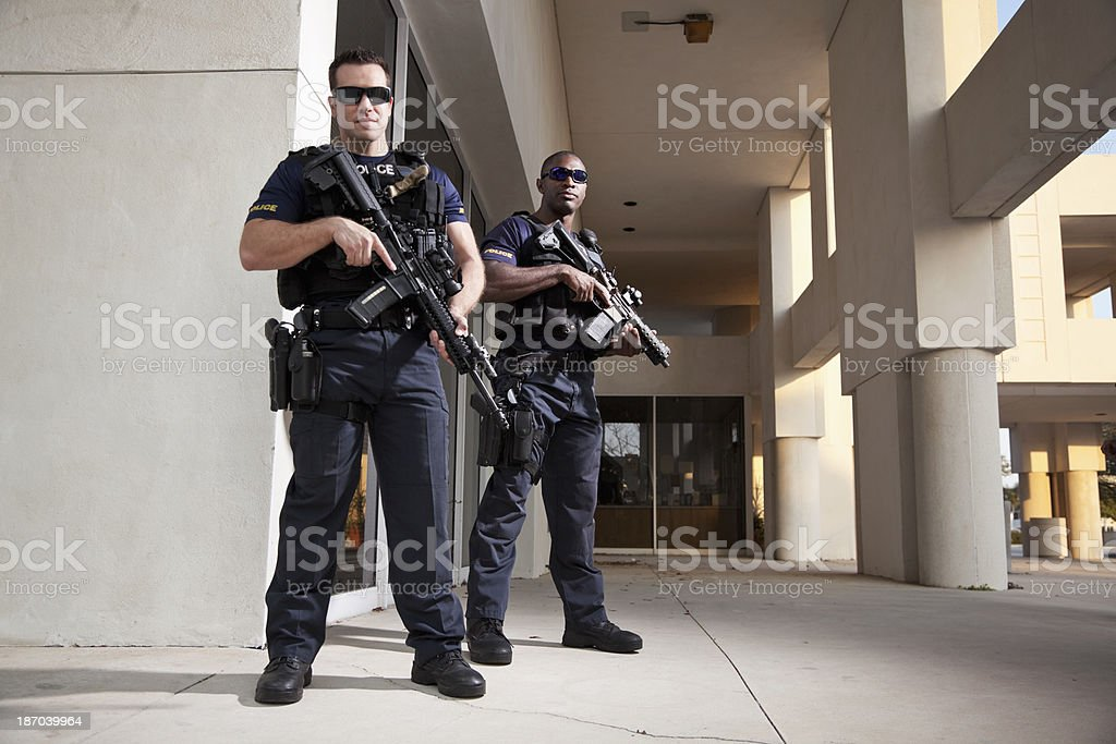 Police officers with rifles stock photo
