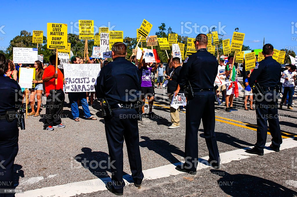 Police on the picket line at an anti-trump protest stock photo