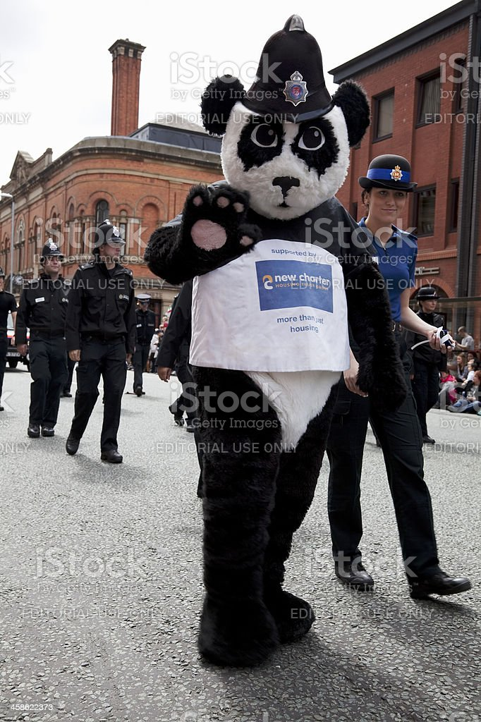 Police panda costume, waving at the crowd stock photo