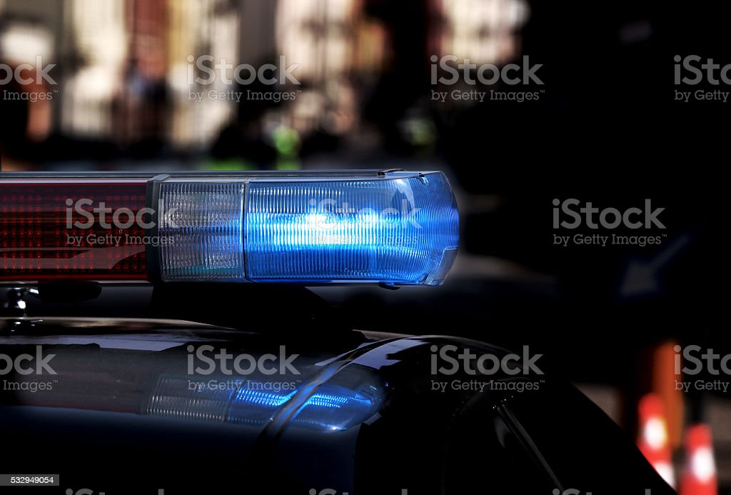 Police patrol car with flashing lights and siren stock photo
