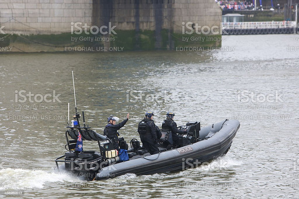 Police patrolling the Thames at Queen's Diamond Jubilee River Pageant stock photo