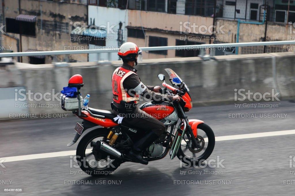Police patrols on motorbike stock photo