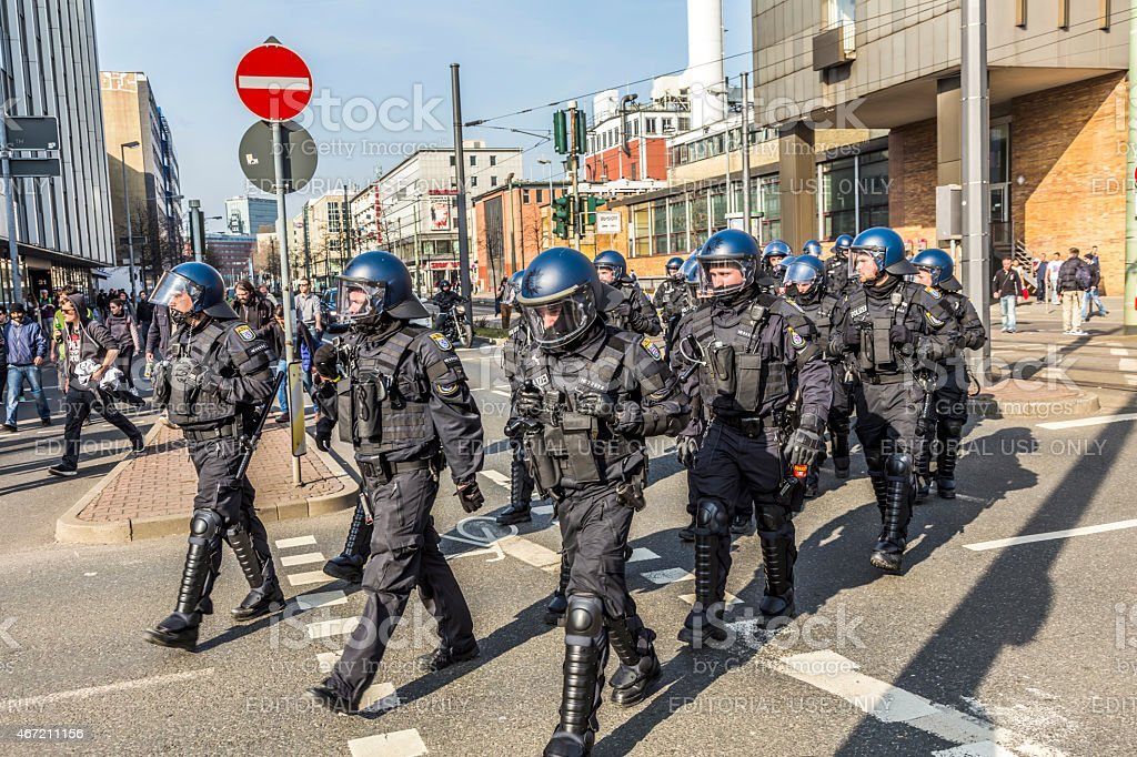 police pays attention for people demonstrating against ECB stock photo