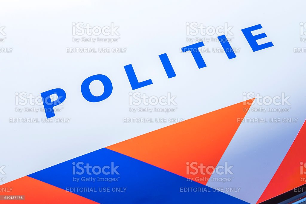 Police - Politie in Dutch on a police car front stock photo
